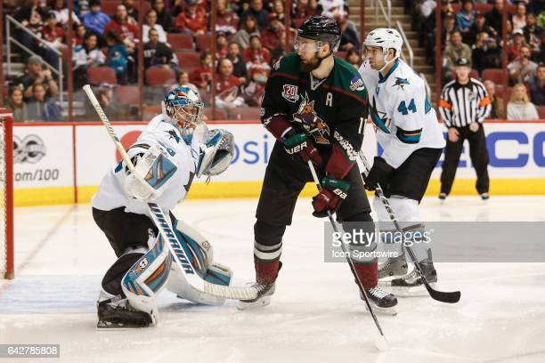 Arizona Coyotes center Martin Hanzal sets a screen in front of San Jose Sharks goalie Aaron Dell during the NHL hockey game between the San Jose...