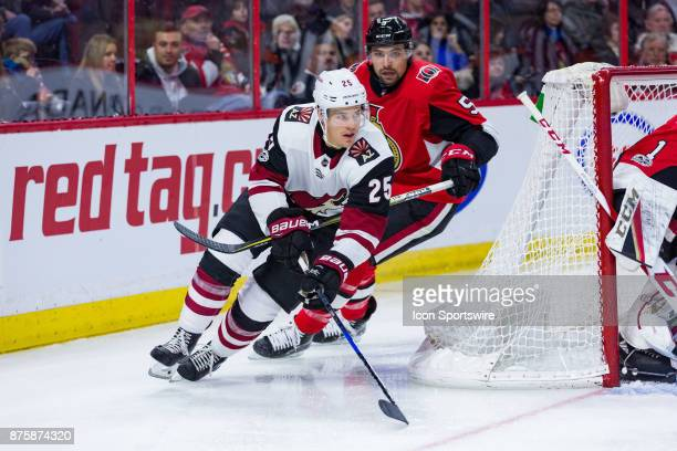 Arizona Coyotes Center Nick Cousins circles the net with Ottawa Senators Defenceman Cody Ceci giving chase during first period National Hockey League...
