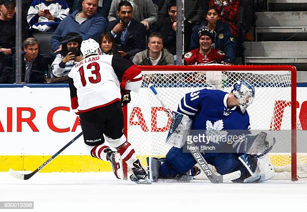 Arizona Coyotes center Peter Holland scores the winning shootout goal on Toronto Maple Leafs goalie Frederik Andersen the Air Canada Centre on...