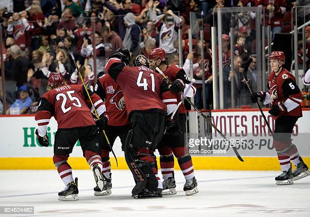 Arizona Coyotes center Ryan White goalie Mike Smith and teammates react after defeating the San Jose Sharks 32 in overtime on November 19 at Gila...