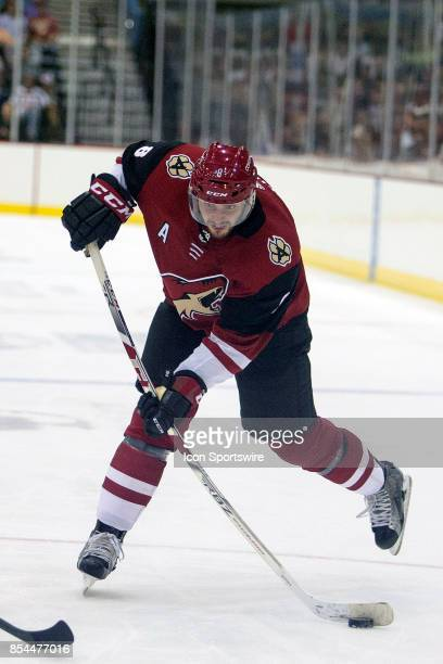 Arizona Coyotes center Tobias Rieder hits the puck during a preseason hockey game between the Anaheim Ducks and Arizona Coyotes on September 25 at...
