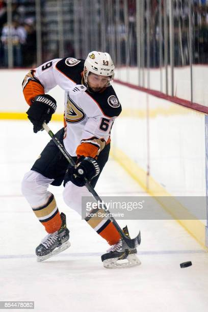 Arizona Coyotes defenseman Adam Clendening controls the puck during a preseason hockey game between the Anaheim Ducks and Arizona Coyotes on...