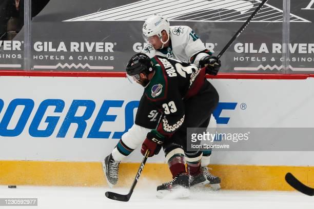 Arizona Coyotes defenseman Alex Goligoski checks San Jose Sharks left wing Patrick Marleau during the NHL hockey game between the San Jose Sharks and...
