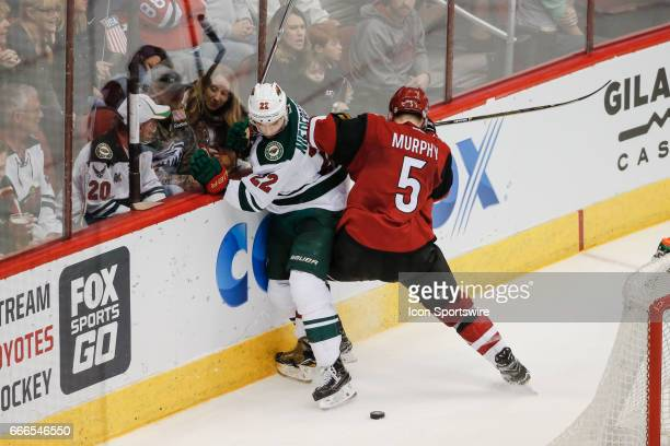 Arizona Coyotes defenseman Connor Murphy checks Minnesota Wild right wing Nino Niederreiter during the NHL hockey game between the Minnesota Wild and...