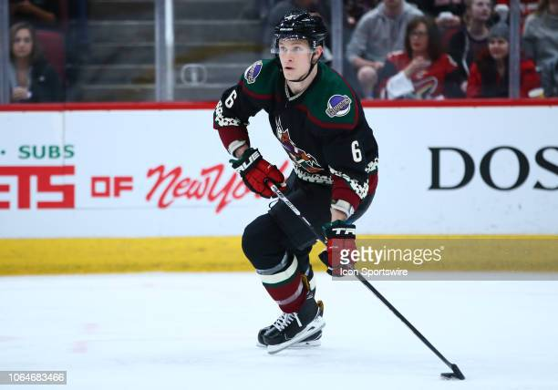Arizona Coyotes defenseman Jakob Chychrun passes the puck during the NHL hockey game between the Arizona Coyotes and the Colorado Avalanche on...