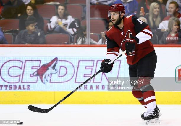 Arizona Coyotes defenseman Jason Demers passes the puck during the NHL hockey game between the New Jersey Devils and the Arizona Coyotes on December...