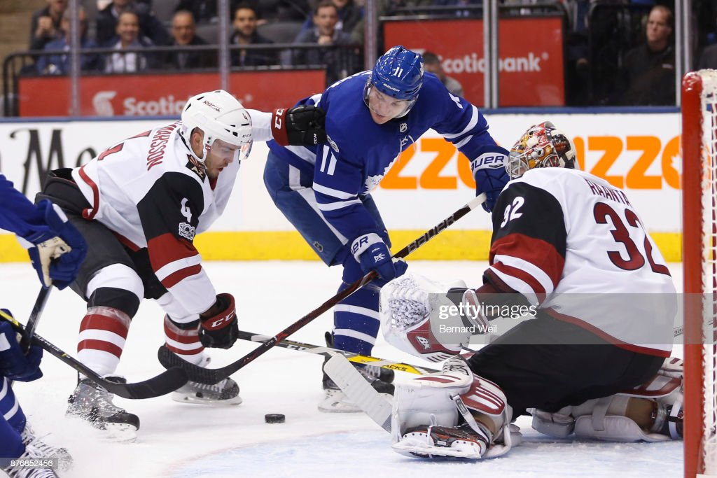 TORONTO, ON - NOVEMBER 20 - Arizona Coyotes defenseman Niklas Hjalmarsson (4) and Toronto Maple Leafs center Zach Hyman (11) fight for the puck in front of Arizona Coyotes goalie Antti Raanta (32) in the 1st period as the Toronto Maple Leafs host the Arizona Coyotes at the Air Canada Centre November 20, 2017.