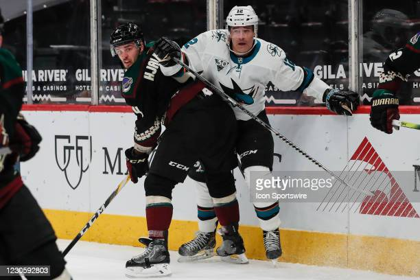 Arizona Coyotes defenseman Niklas Hjalmarsson checks San Jose Sharks left wing Patrick Marleau during the NHL hockey game between the San Jose Sharks...