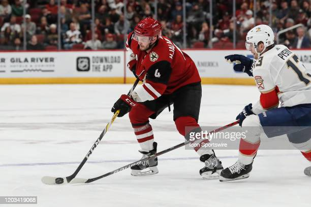 Arizona Coyotes defenseman Niklas Hjalmarsson controls the puck during the NHL hockey game between the Florida Panthers and the Arizona Coyotes on...