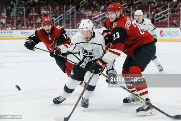 Arizona Coyotes defenseman Oliver EkmanLarsson and Los Angeles Kings defenseman Oscar Fantenberg fight for the puck during the preseason NHL hockey...
