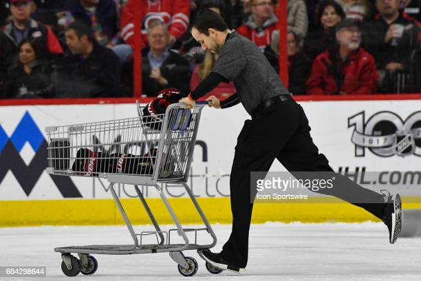 Arizona Coyotes equipment manager uses shopping cart to deliver gear to the bench in a game between the Arizona Coyotes and the Carolina Hurricanes...