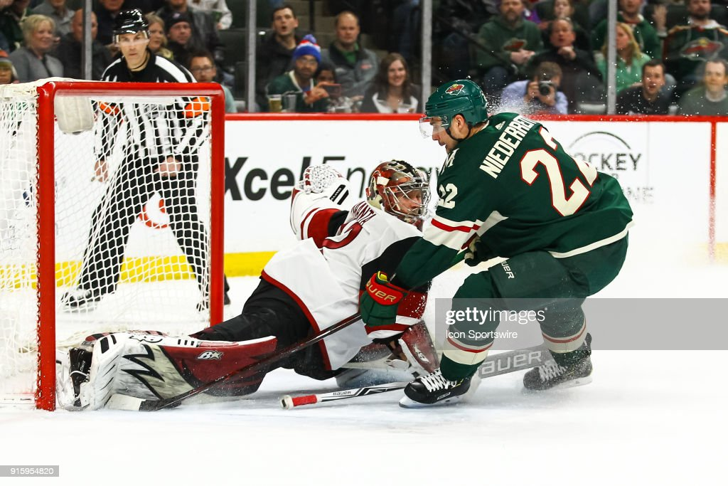 Arizona Coyotes goalie Antti Raanta (32) makes a save on Minnesota Wild right wing Nino Niederreiter (22) in the 1st period during the Western Conference game between the Arizona Coyotes and the Minnesota Wild on February 8, 2018 at Xcel Energy Center in St. Paul, Minnesota.