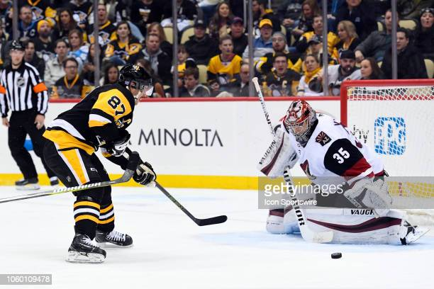 Arizona Coyotes Goalie Darcy Kuemper makes a save on Pittsburgh Penguins Center Sidney Crosby during the third period in the NHL game between the...