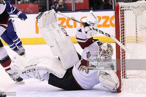 TORONTO ON DECEMBER 15 Arizona Coyotes goalie Mike Smith looks for the puck after making a save as the Toronto Maple Leafs lose to the Arizona...