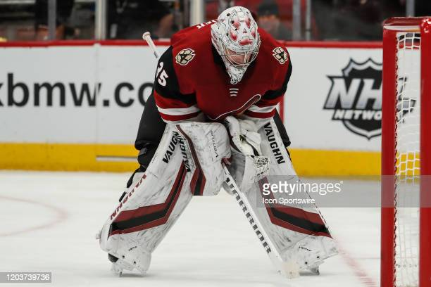 Arizona Coyotes goaltender Darcy Kuemper looks down during the NHL hockey game between the Florida Panthers and the Arizona Coyotes on February 25,...