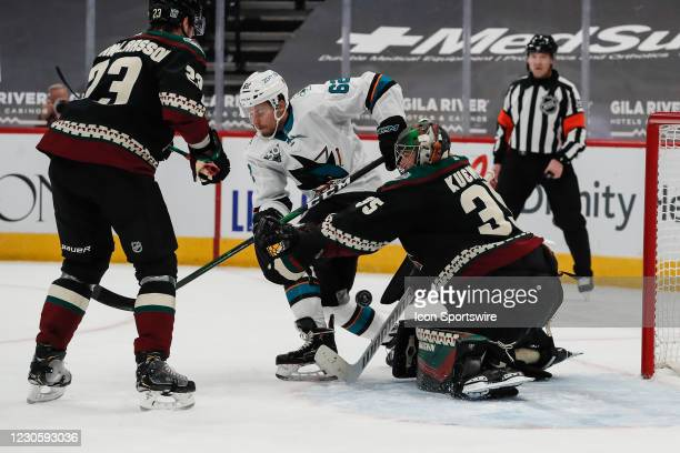Arizona Coyotes goaltender Darcy Kuemper makes a save on San Jose Sharks right wing Kevin Labanc during the NHL hockey game between the San Jose...