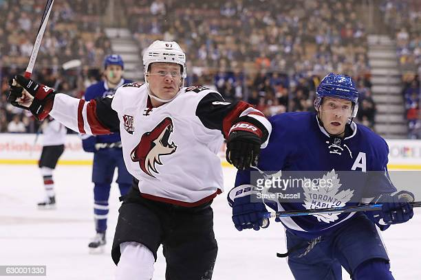 TORONTO ON DECEMBER 15 Arizona Coyotes left wing Lawson Crouse looks for way around Toronto Maple Leafs defenseman Matt Hunwick as the Toronto Maple...