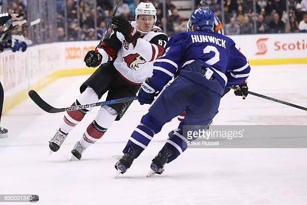 Arizona Coyotes left wing Lawson Crouse looks for way around Toronto Maple Leafs defenseman Matt Hunwick as the Toronto Maple Leafs play the Arizona...