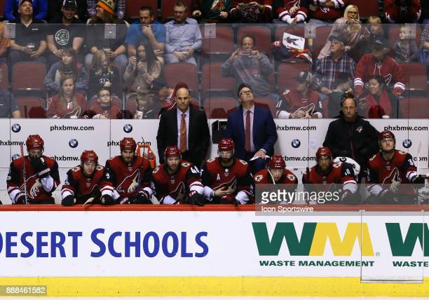 Arizona Coyotes players and staff watch the action during the NHL hockey game between the New Jersey Devils and the Arizona Coyotes on December 2...