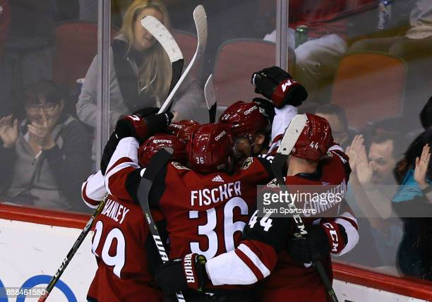 Arizona Coyotes players celebrate a goal during the NHL hockey game between the New Jersey Devils and the Arizona Coyotes on December 2 2017 at Gila...