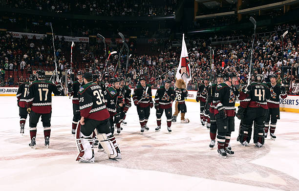 Arizona Coyotes players salute the fans on Throwback Night following a 3-2  overtime shootout 5a82f934a