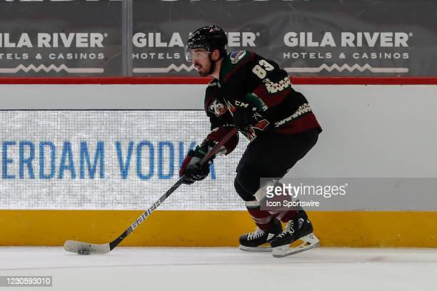 Arizona Coyotes right wing Conor Garland skates with the puck during the NHL hockey game between the San Jose Sharks and the Arizona Coyotes on...