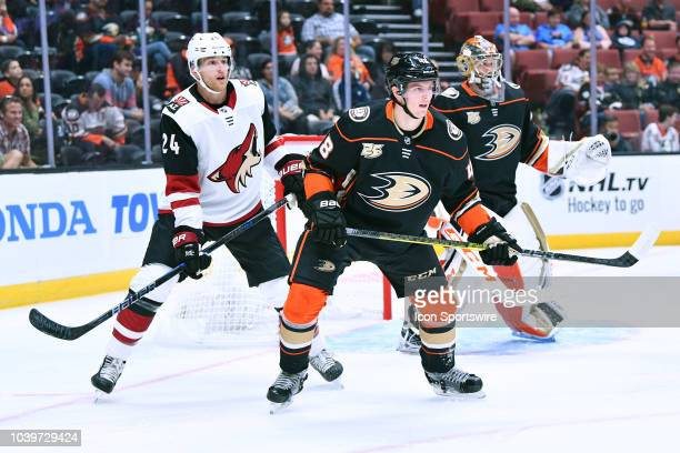 Arizona Coyotes right wing Hudson Fasching and Anaheim Ducks center Isac Lundestrom in front of the Anaheim Ducks goalie John Gibson during a NHL...