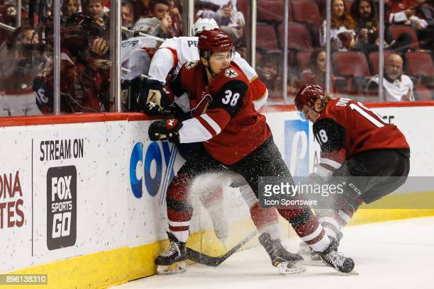 Arizona Coyotes right wing Nicholas Merkley checks Florida Panthers defenseman Alexander Petrovic during the NHL hockey game between the Florida...