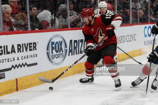 Arizona Coyotes right wing Vinnie Hinostroza controls the puck during the NHL hockey game between the Florida Panthers and the Arizona Coyotes on...