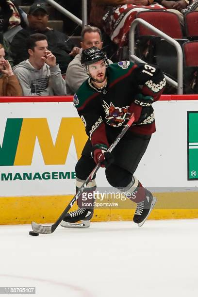 Arizona Coyotes right wing Vinnie Hinostroza skates with the puck during the NHL hockey game between the New Jersey Devils and the Arizona Coyotes on...