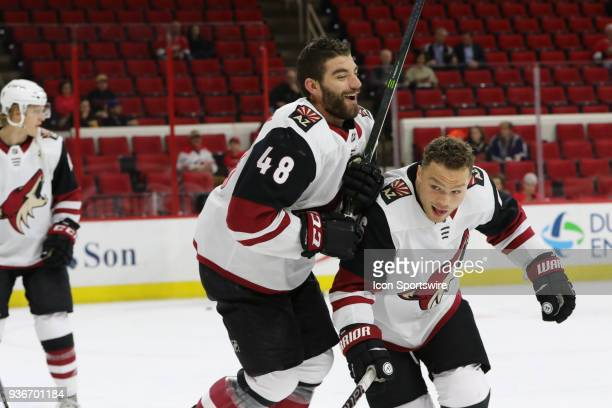 Arizona Coyotes Winger Jordan Martinook and Arizona Coyotes Left Wing Max Domi run into each other during the warmups of the Carolina Hurricanes game...