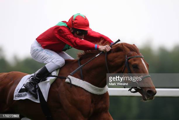 Arizona Desert ridden by Adrie de Vries leads the field in the Munich Polo Center Rennen during the Lotto Festival 2013 at Galopp Munich on June 9...