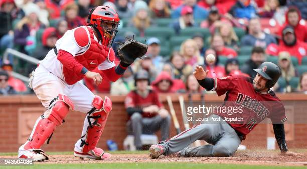 Arizona Diamodnbacks' AJ Pollock scores past St Louis Cardinals catcher Yadier Molina on a single by Nick Ahmed in the seventh inning during a game...