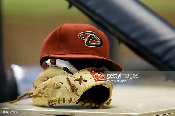 Arizona Diamondbacks cap and glove sits on the edge of the Diamondbacks dugout during the game against the Milwaukee Brewers at Miller Park on April...