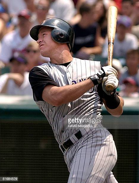 Arizona Diamondbacks catcher Damian Miller hits a two run double off of Cleveland Indians pitcher Danys Baez duriing the first inning on 30 June 2002...