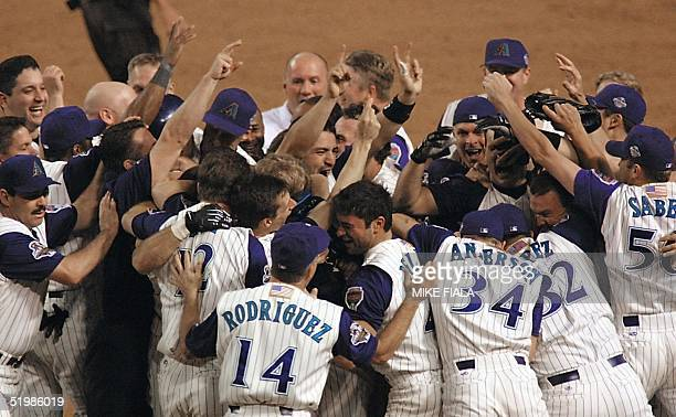 Arizona Diamondbacks celebrate their win of Game 7 of the World Series in Phoenix 04 November 2001. The Diamondbacks rallied with two runs in the...