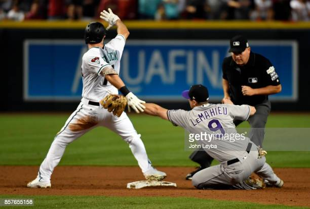 Arizona Diamondbacks center fielder AJ Pollock gets past the tag attempt by Colorado Rockies second baseman DJ LeMahieu in the first inning during...