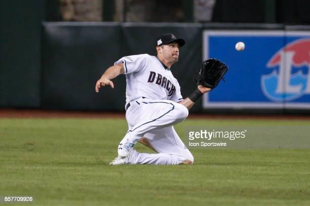 Arizona Diamondbacks center fielder AJ Pollock makes a sliding catch during the MLB National League Wild Card baseball game between the Colorado...