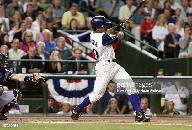 Arizona Diamondbacks' Danny Bautista hits a double scoring Tony Womack during the first inning of Game 6 of the World Series against the New York...