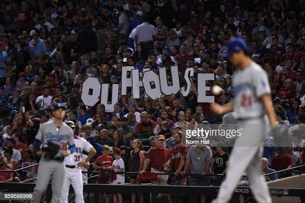 Arizona Diamondbacks fans hold a sign during the third inning of the National League Divisional Series game three against the Los Angeles Dodgers at...