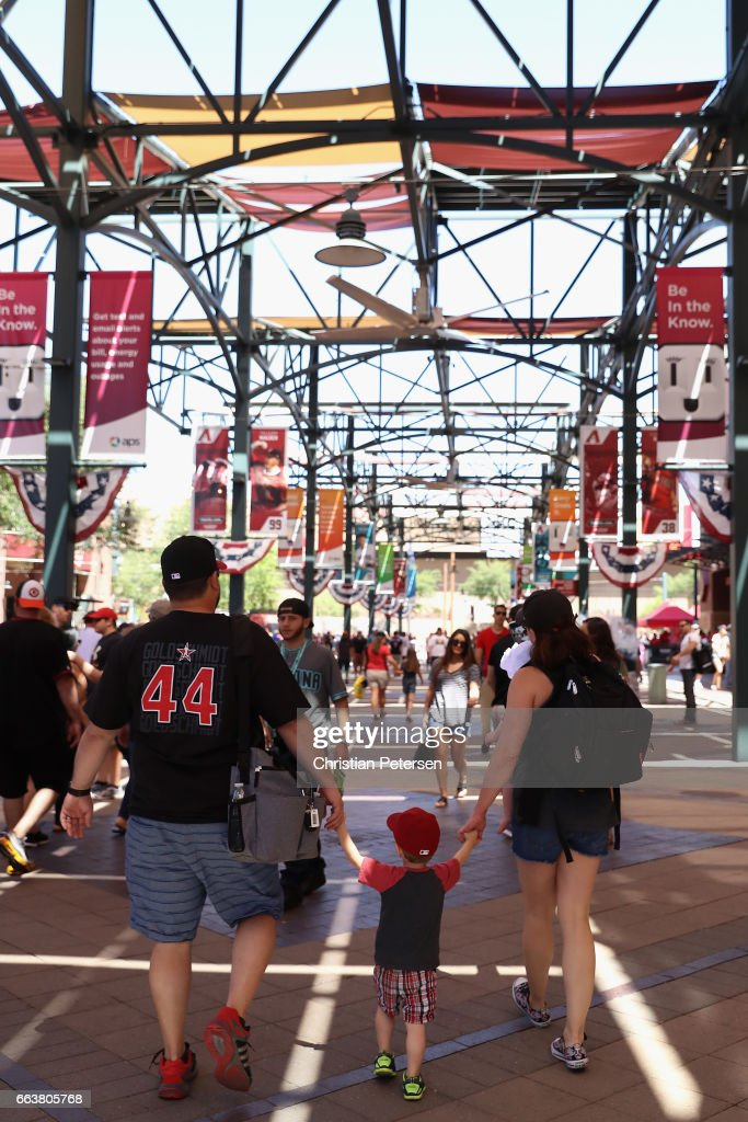 Arizona Diamondbacks fans mingle outside of Chase Field before the MLB opening day game against the San Francisco Giants on April 2, 2017 in Phoenix, Arizona.