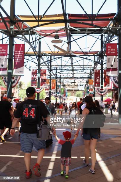 Arizona Diamondbacks fans mingle outside of Chase Field before the MLB opening day game against the San Francisco Giants on April 2 2017 in Phoenix...