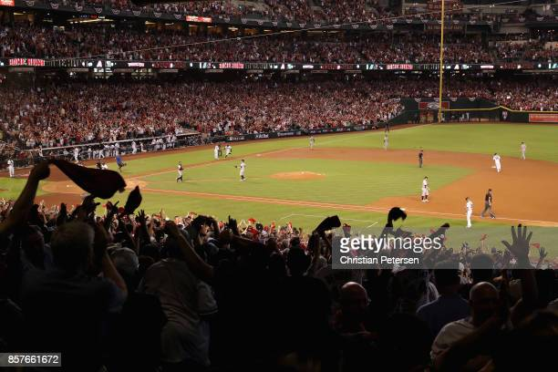Arizona Diamondbacks fans react after a threerun home run by Paul Goldschmidt during the bottom of the first inning of the National League Wild Card...