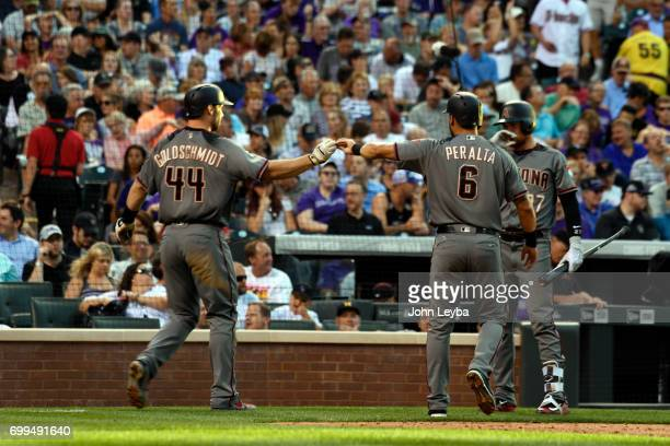 Arizona Diamondbacks first baseman Paul Goldschmidt and right fielder David Peralta celebrate after scoring on a third baseman Jake Lamb double in...