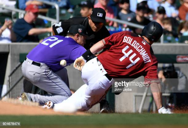 Arizona Diamondbacks first baseman Paul Goldschmidt slides safe at third base on a single by third baseman Jake Lamb as Colorado Rockies starting...