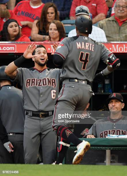 Arizona Diamondbacks left fielder David Peralta greets second baseman Ketel Marte at the dugout after Marte hit a solo home run in the second inning...