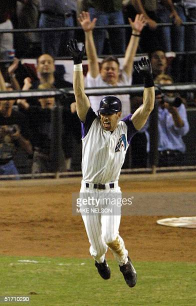 Arizona Diamondbacks left fielder Luis Gonzalez celebrates after he hit an RBI single in the bottom of the 9th inning to win Game 7 of the World...