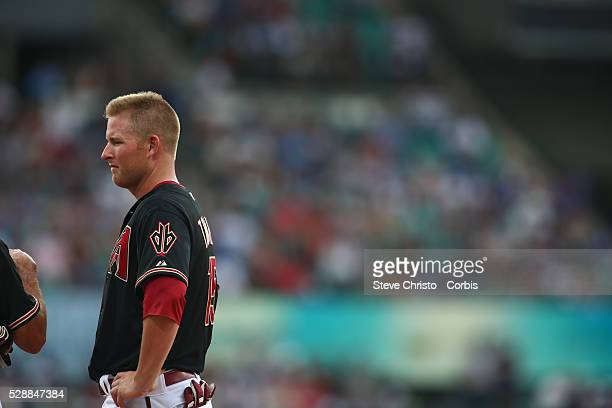 Arizona Diamondbacks Mark Trumbo talks to first base coach Dave Mackay during the match against the Los Angeles Dodgers at the Sydney Cricket Ground...
