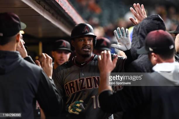 Arizona Diamondbacks outfielder Adam Jones celebrates with teammates in the dugout after hitting a solo home run during the Major League Baseball...