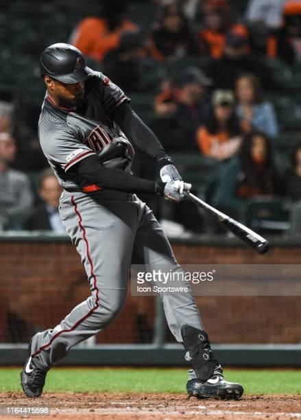 Arizona Diamondbacks outfielder Adam Jones hits a solo home run during the Major League Baseball game between the Arizona Diamondbacks and the San...
